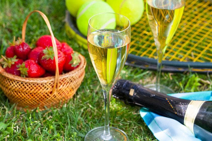 Strawberries, champagne and tennis equipment