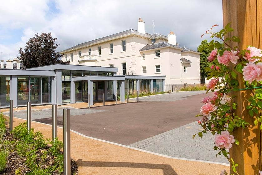 The exterior of New Court retirement living apartments in Cheltenham.