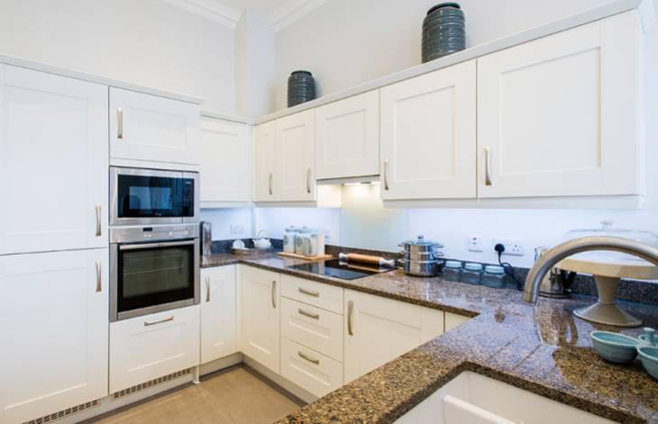 A typical kitchen at New Court, Cheltenham, showing fully integrated appliances.